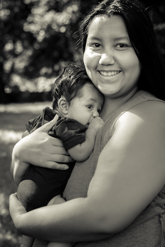 Perla Castaneda and Giovonni enjoy Reed Park, which is near their home. Photo by Fran Dwight.