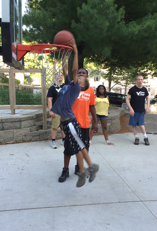 Basketball is a popular activity at Peace House whenever weather permits.