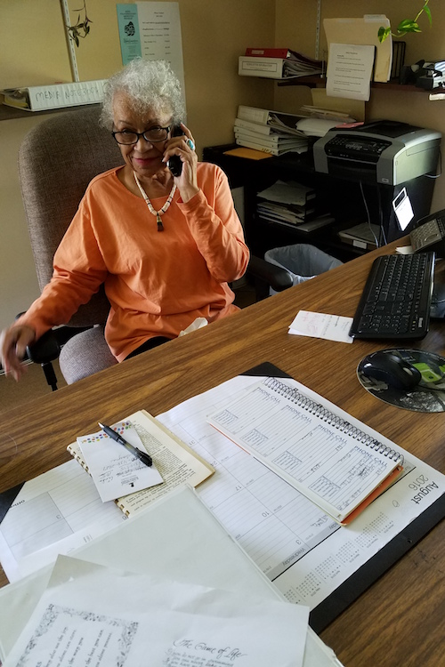 At 84, Elnora Rodriguez decided to volunteer at KENA where she files papers and answers phones.