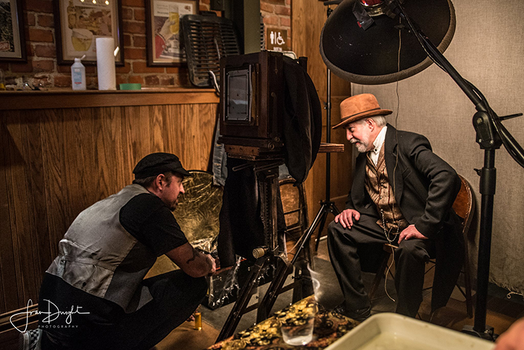 Photographer Fran Dwight catches Eric Hennig in action as he prepares a tintype.