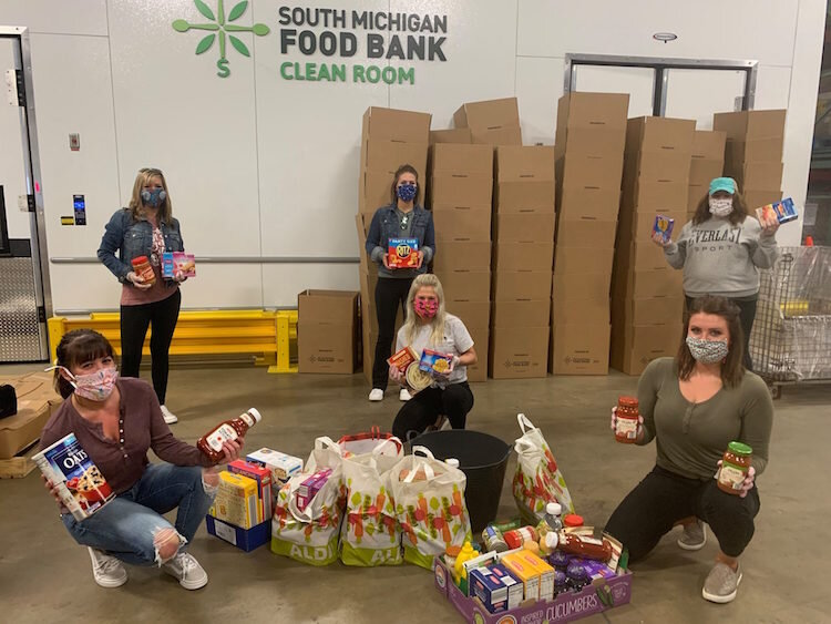FireKeepers Casino volunteers are among those helping to keep the community healthy and fed by wearing masks, gloves, and social-distancin as they packed food.