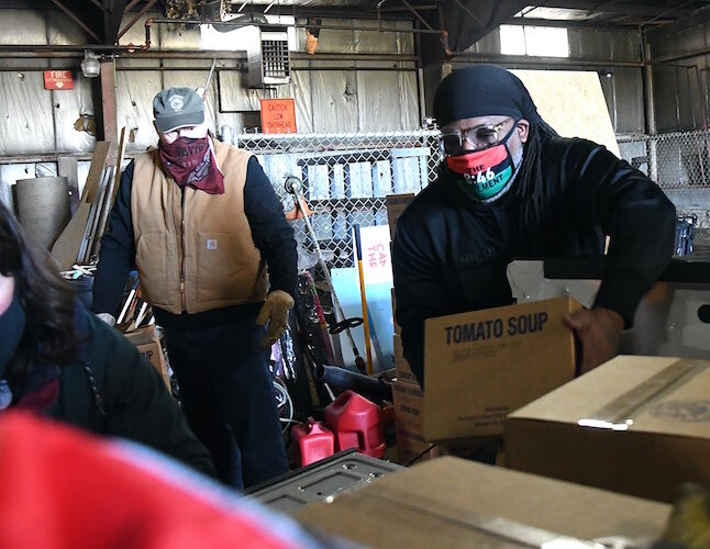 On Wednesday morning volunteers from churches throughout Battle Creek, including the Church of Jesus Christ of Latter-Day Saints, New Level Sports Ministries, unloaded and stacked a truckload of donated food for distribution over the coming weekend.