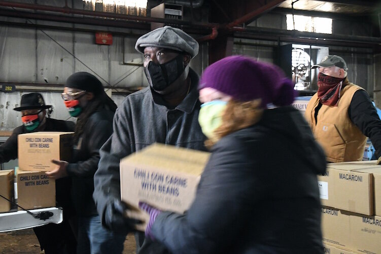 On Wednesday morning volunteers from churches throughout Battle Creek, including the Church of Jesus Christ of Latter-Day Saints, New Level Sports Ministries, unloaded and stacked a truckload of donated food for distribution over the coming.