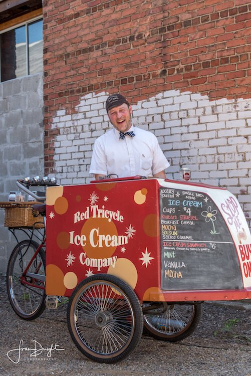 "The owner of Red Tricycle Ice Cream, Ken Quayle, enjoys the old timey aspect of his bicycle ice cream business because he's ""kind of a vintage guy."""