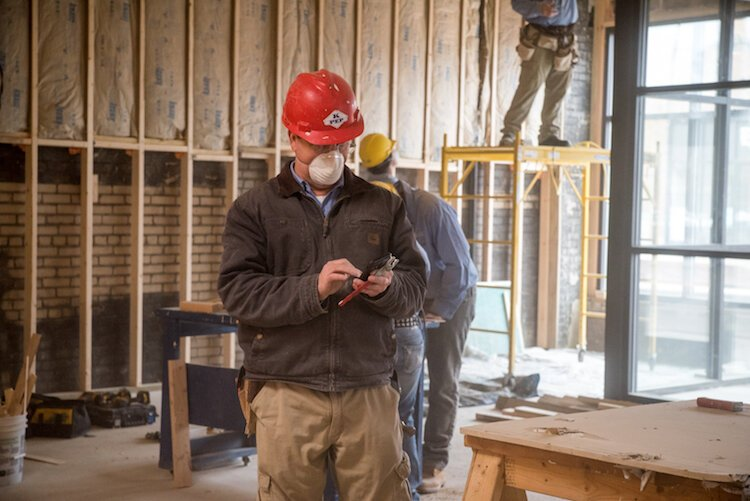 KPEP building trades instructor Tim Thornton, works among a crew of the program's building trades students.