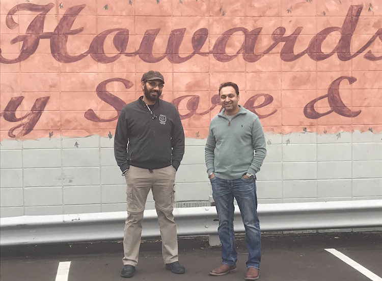 Gary Singh and Vik Bawa in front of Howard's Party Store where they work together.  They went to Lansing with the ENA to fight changes to state rules regarding alcohol sales.