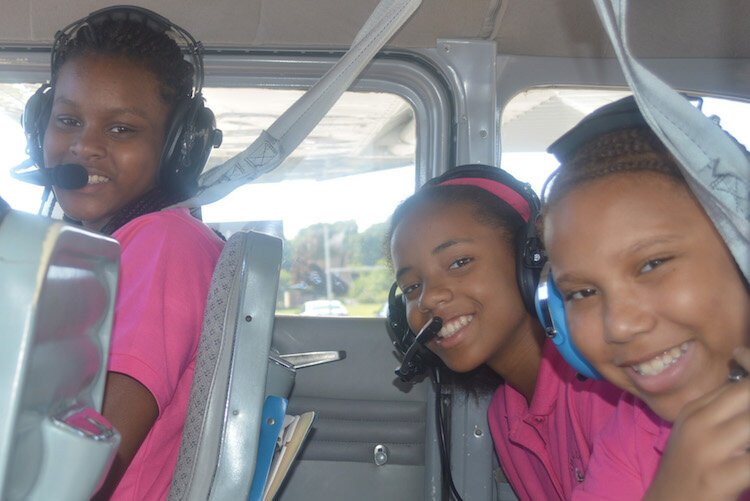 Merze Tate explorers on a plane ride
