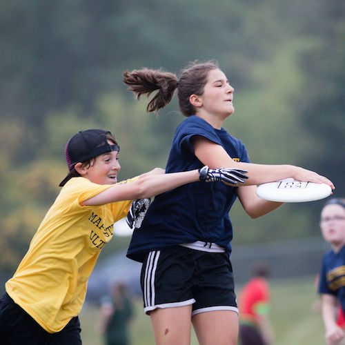Haniya Frayer catches disc, while Owen Quayle defends. Photo by Kimberly Moss