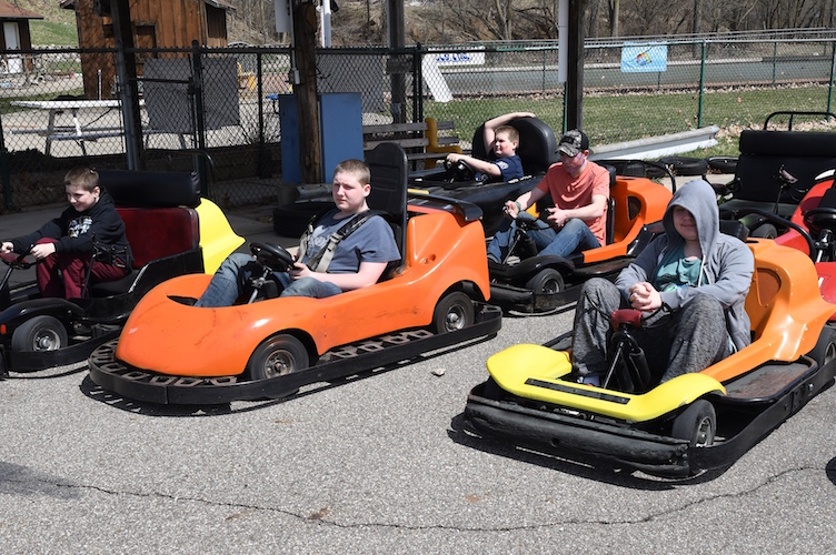 Kids eager to take Go-Karts for a ride.