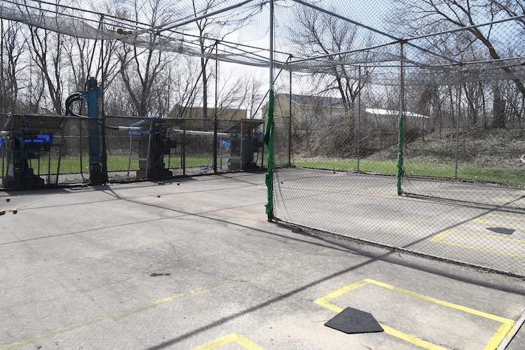 Batting cages offering fast baseball and softball pitches.