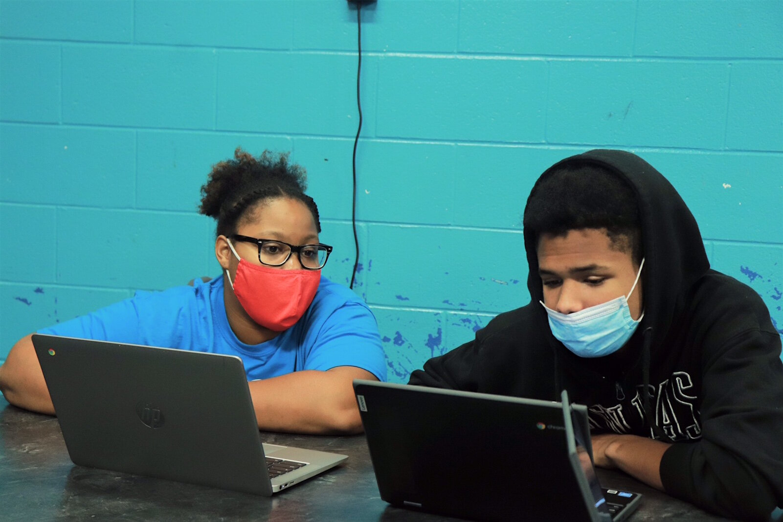 Youngsters compare notes on laptops at the Boys & Girls Club.