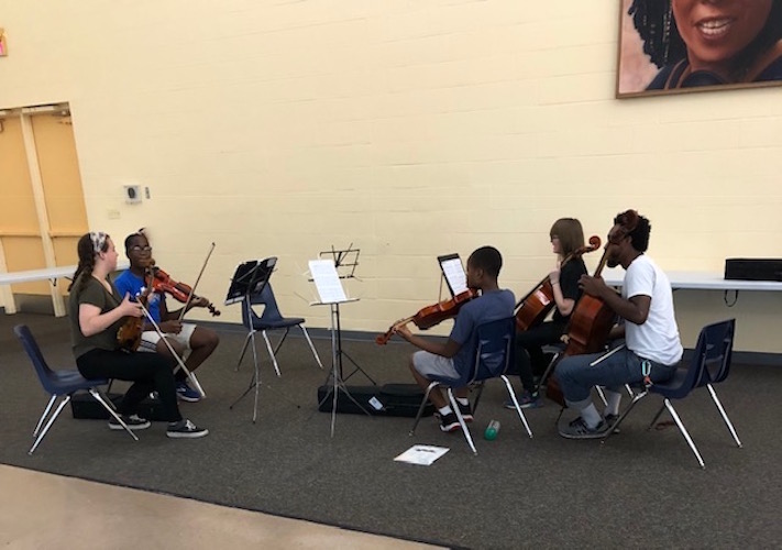 The Helen Fox Gospel Music String ensemble performed recently with their teacher, cellist Jordan Hamilton, at the Douglass Community Association's community room.
