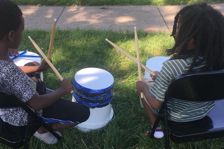 At Mt. Zion Church's community cookout at Interfaith Homes on the Northside, Rootead provided drumming and free books, courtesy of the Great Start Collaborative.