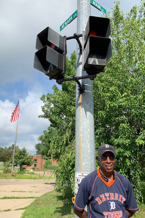 At Main Street and Newark Avenue in front of Post Franklin Elementary School crossing guard Lamount Horton is a neighborly presense.