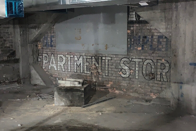 A sign for a long lost department store is still visible inside The Milton.