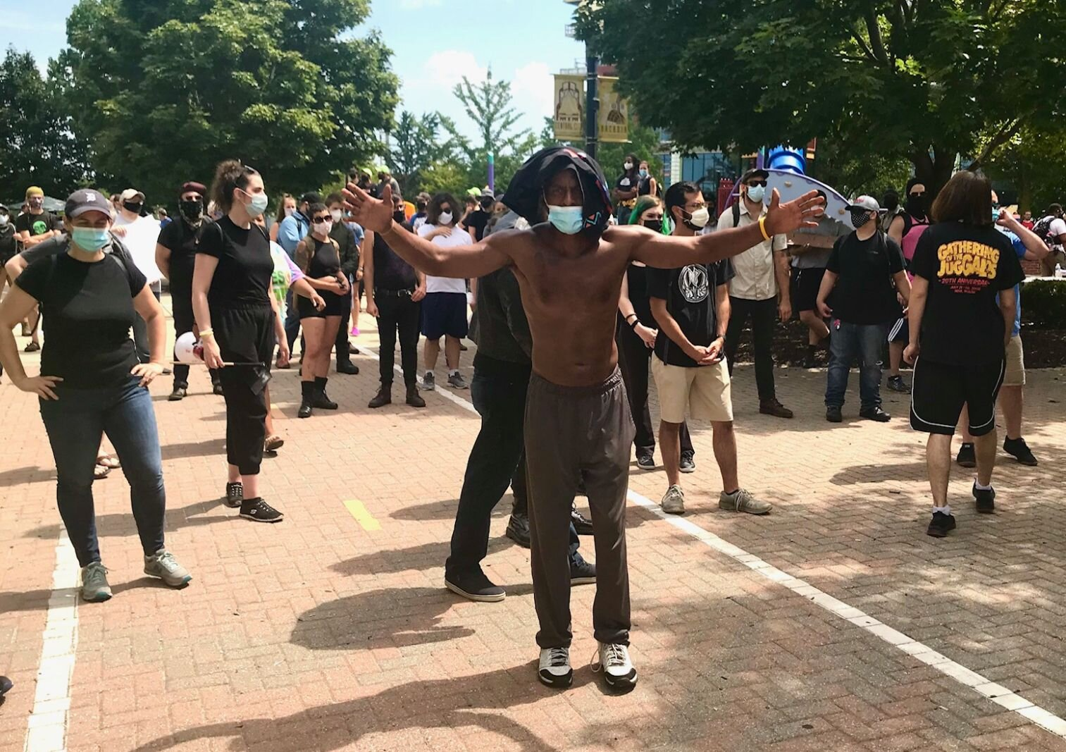 Counter-protesters wait at the eastern entrance of Arcadia Creek Festival Place in downtown Kalamazoo for the arrival of alt-right, now-fascist group the Proud Boys.