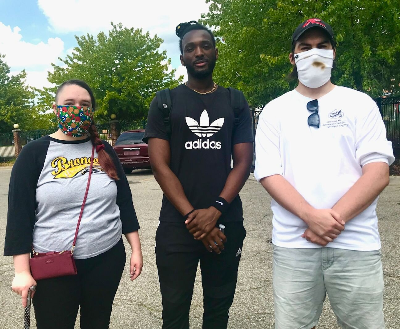 From left are counter-protesters Brianna Mull, Winston Ssessanga and Chad Lenczycki, all of Kalamazoo.