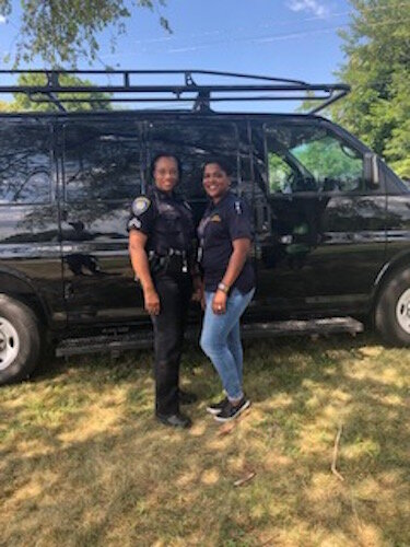 Corporal Shawn O'Bryant, left, and Kelly Dillman, the Community Outreach Liaison for BCPD at a PAL and New Level Sports event earlier in 2019.