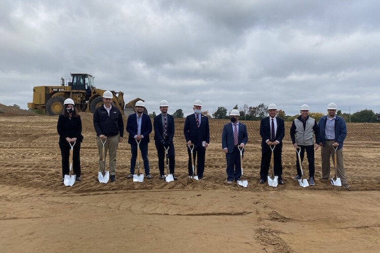 Participants in a groundbreaking ceremony held in late September for the new spec building on Watkins Road