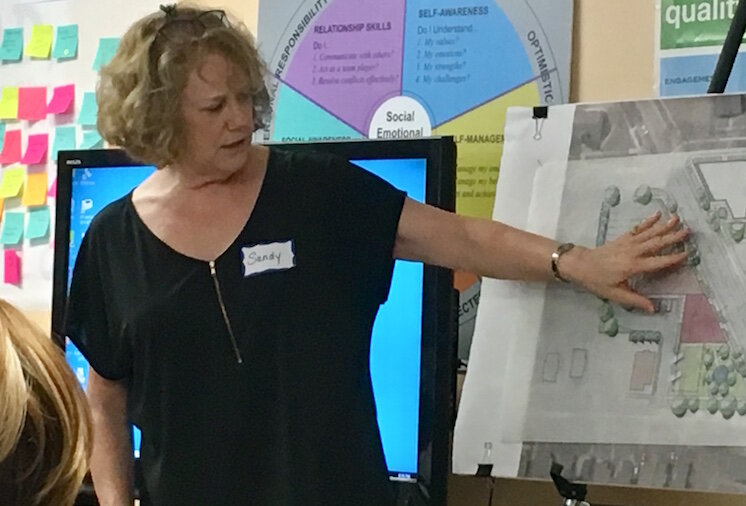 Sandy Bliesener, of O'Boyle, Cowell, Blalock & Associates, talks about creating a vision for the 1600 block of East Main Street.