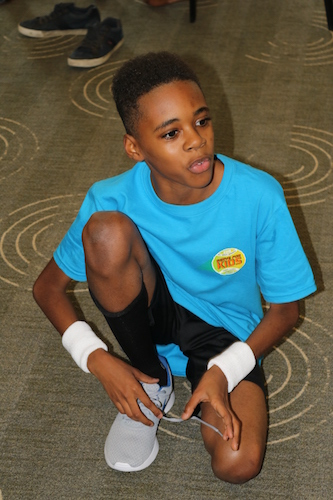 S.T.R.E.E.T. youth learn tennis skills while having fun at one of their many enrichment programs through the year.