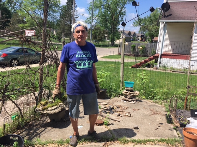 Scott Wilson works to save trees in an arbor he has created in Edison.