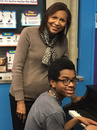 Bertha Barbee-McNeal, a founding Velvelette, teaches student Caleb Jackson, 12, at the Helen Fox Gospel Music Center.