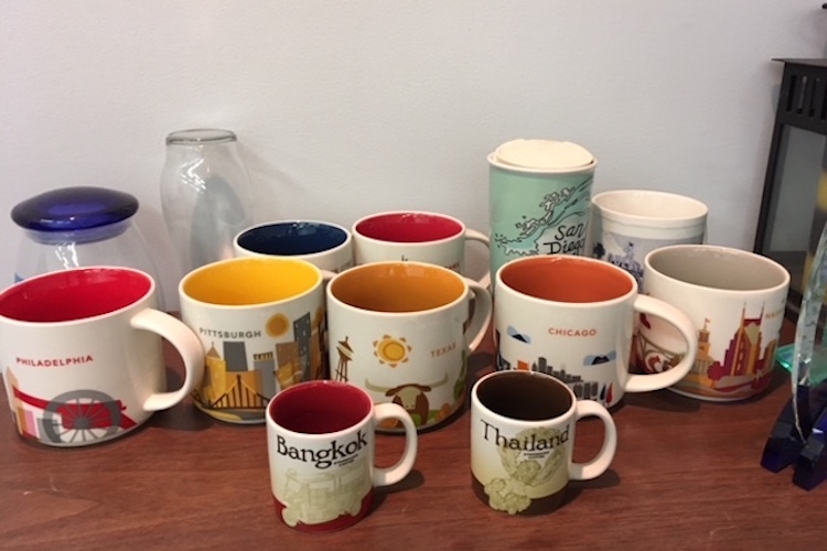 Sid Ellis, newly appointed Executive Director of the Douglass, has found a place in his office for his large collection of Starbucks cups