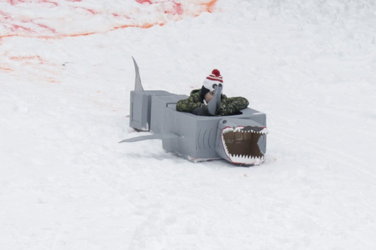 Sliding downhill in a shark at the 2019 Festivus organized by BCMAMS.