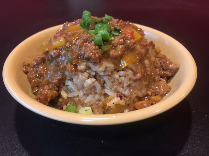 Cookie's Dirty Rice is a popular choice: white rice 'dirtied with meat,' peppers, gravy and the holy trinity, a Cajun spice trio.