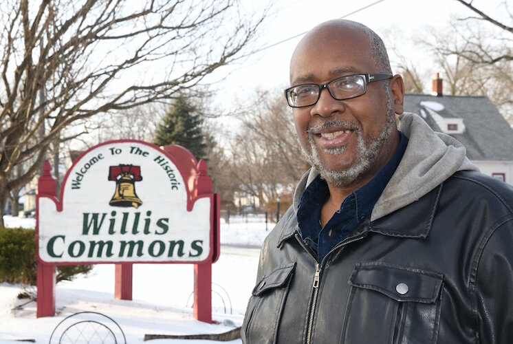 Count Laws stands by the sign commemorating Willis Commons.