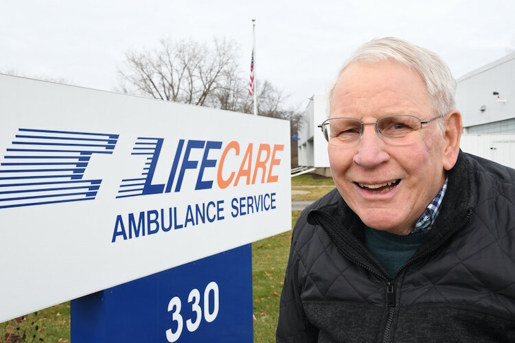 Larry Anderson outside the LifeCare Ambulance Services offices
