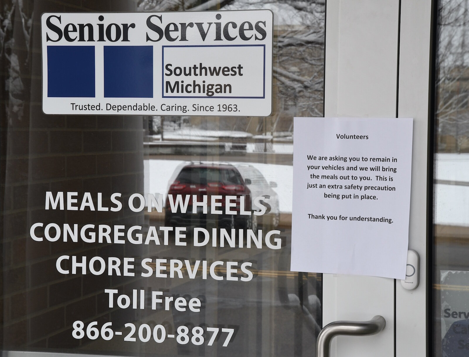 Sign on the door to Senior Services at the Kool Center in downtown Battle Creek.