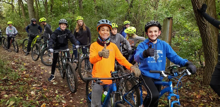 In a pre-COVID activity, Portage Central Middle School students learn Wearing a helmet, rules of the road, maintenance, basic pedaling as they improve their mental focus.