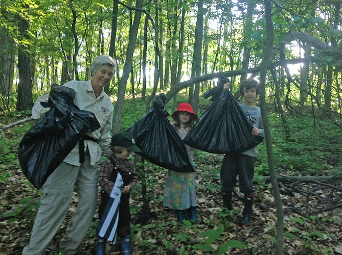 Youngsters pull garlic mustard at a Southwest Michigan Land Conservancy Preserve.