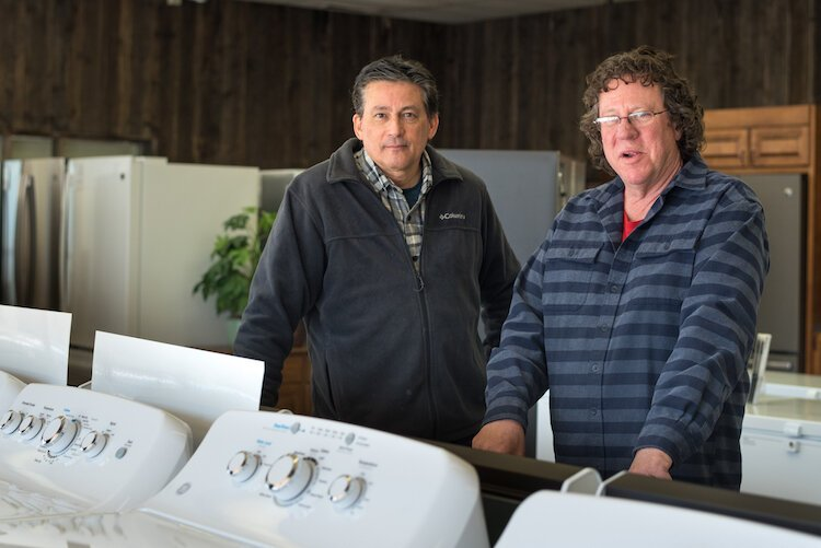 David Miyagawa, left, and his brother Thomas, right, grew up dusting off appliances and performing other chores before George's Appliance Co., a business started in 1940 by their late grandfather, passed into their hands.