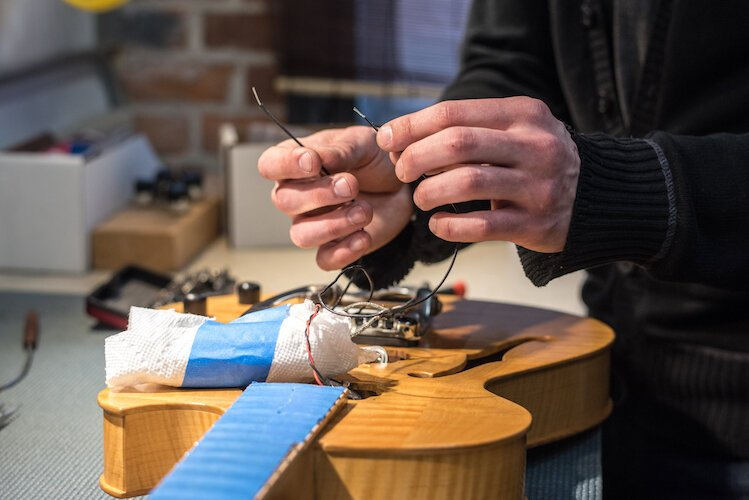The craftsmen at Kal-Tone Musical Instruments Co. do repair work on acoustic and electric guitars, mandolins, banjos and other stringed instruments.