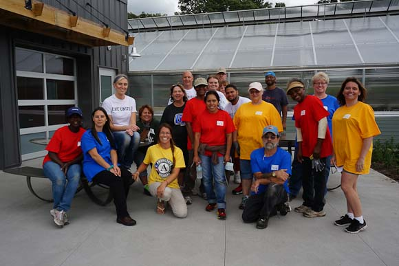 Pfizer volunteers work at Riverview Launch
