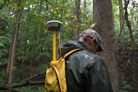 Vic Bogosian, natural resources manager records location data from antenna in backpack