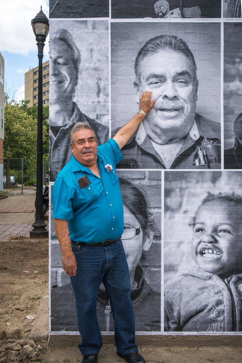 An Edison resident admires his photo on the wall of the former Color Lab. Photo by Fran Dwight