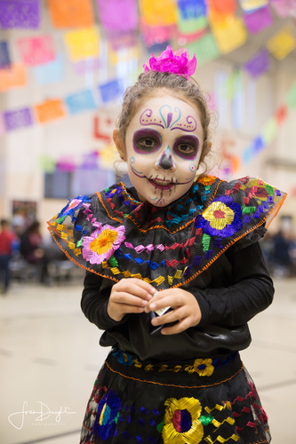 Celebrating Dia de los Muertos. Photo by Fran Dwight