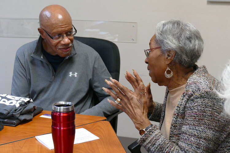 Leonard Harris and Dorothy McClendon talk together at a recent Sacred Conversations Book Group meeting.