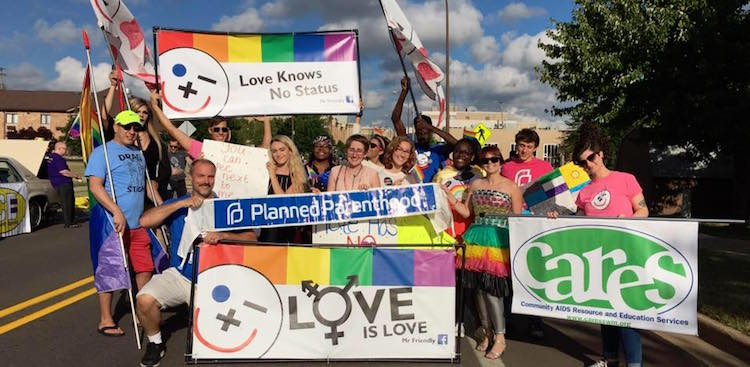 Walking with Planned Parenthood in Battle Creek Pride Parade.
