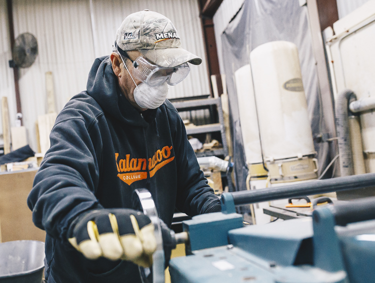 Kzoo Makers member Richard Kent runs a wood planer.