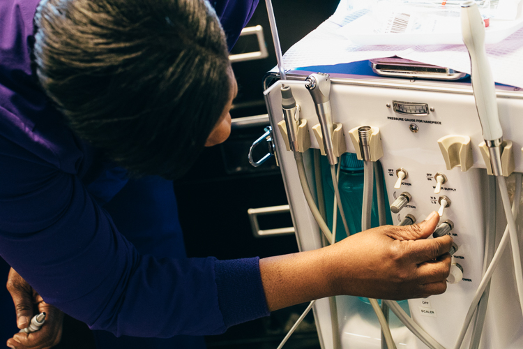 All of Tiffany Burns hygienist equipment, including the suction machine, fits in one suitcase.