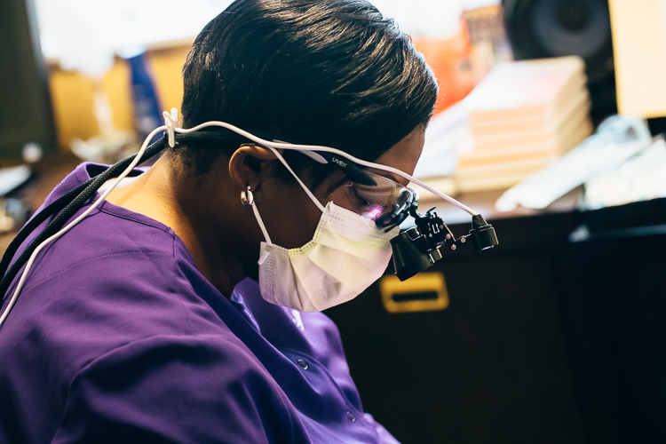 Tiffany Burns, the director and hygienist of Smile Savers, is cleaning teeth at New Village Park Apartments.
