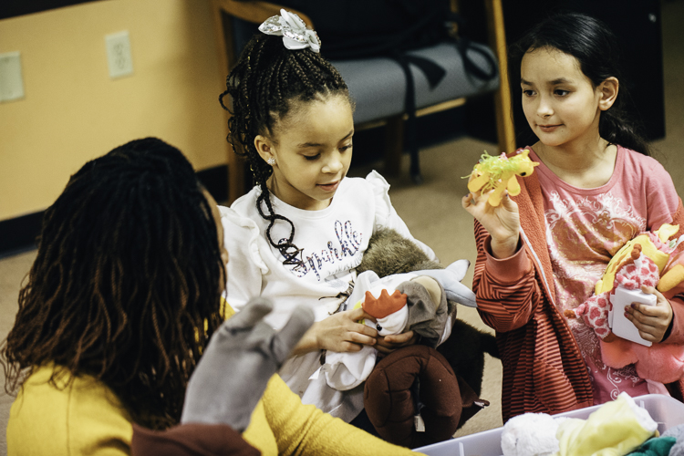 Dolls and stuffed animals provide lots of play options for CHAMPS youth.