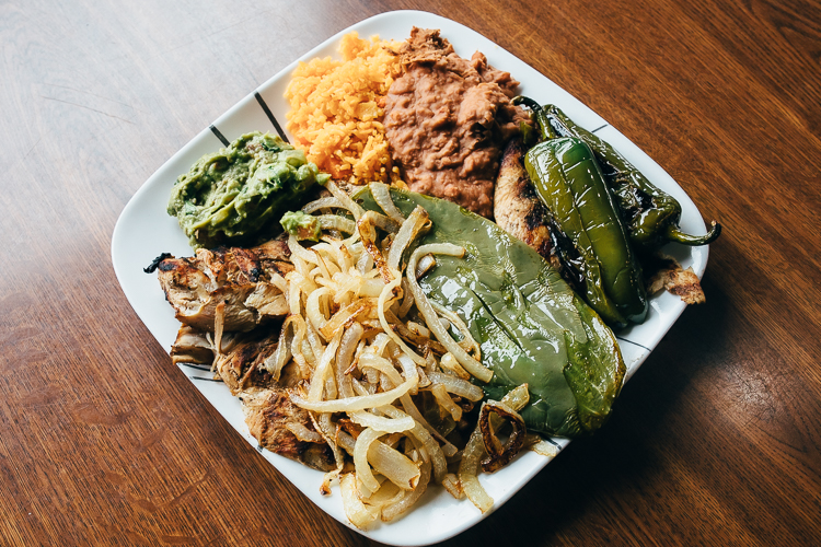 In addition to tacos, a patron favorite, Lolita's serves several plates, including this Carne Asada, a thin grilled steak with grilled cactus, grilled onions, avocado, and refried beans.
