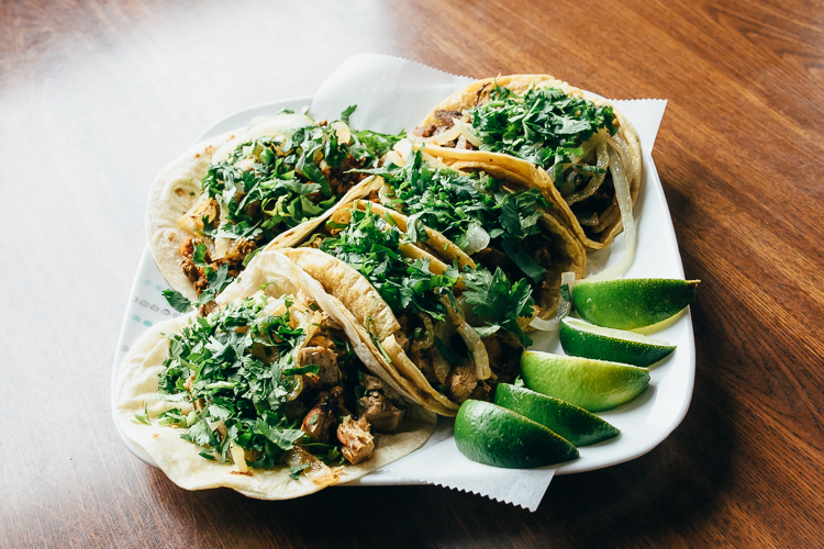 Tacos at Lolita's are served Mexican-style (with cilantro and grilled onions) or American style (shredded cheese, tomatoes, lettuce, and sour cream).