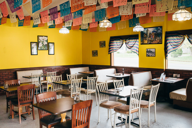Inside Lolita's Tacos, the décor features bright colors and paper flags made in Mexico.